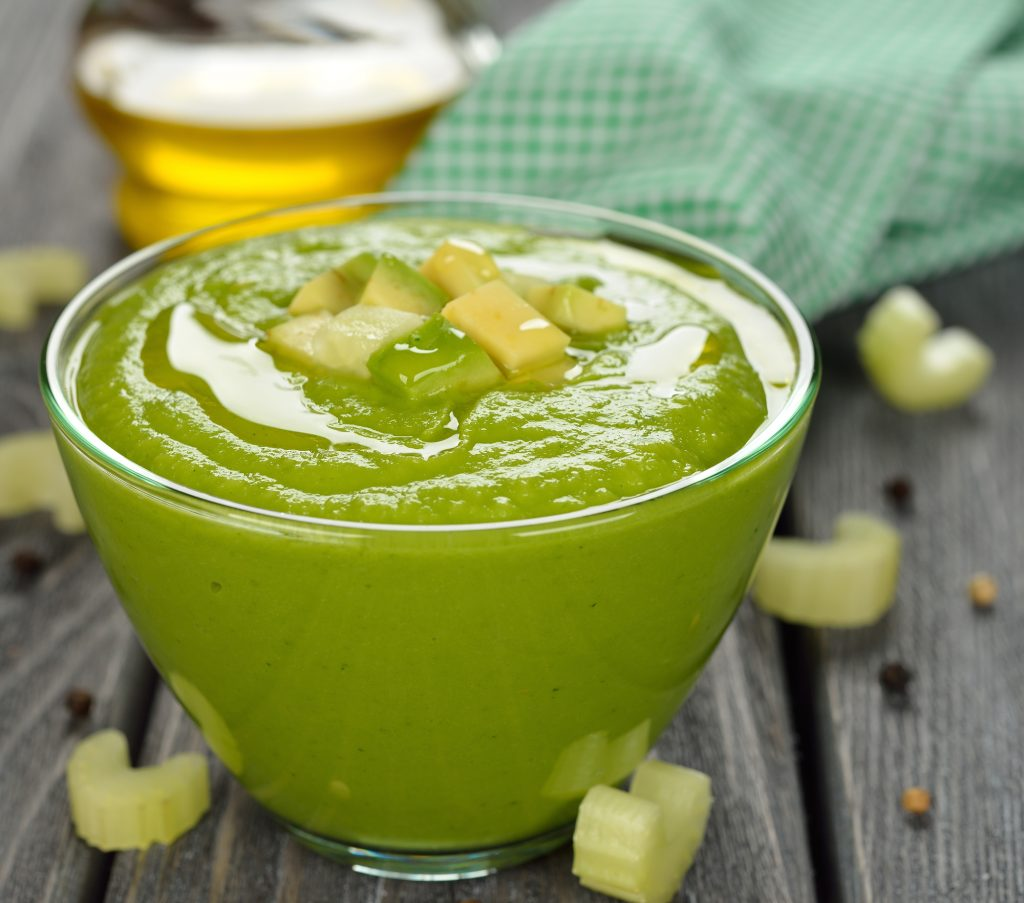 green gazpacho on a gray background
